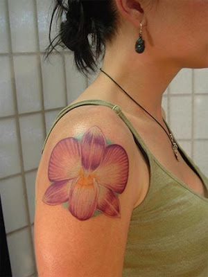 Beautiful orchid flower tattoo engraved on the feet using nice colors. Phoenix Bird With Orchid Flower Tattoo. The meanings of orchids are very