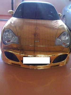 gold plated porsche