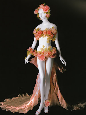 This daring flora inspired wedding gown made of silk flowers with a pink