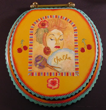 A collection of hand-painted toilet seats