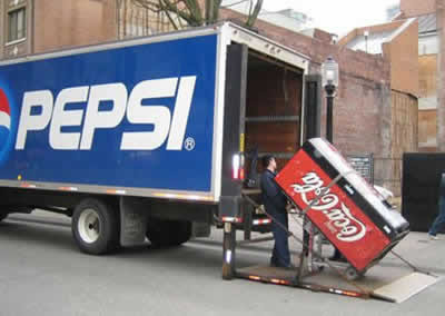 Coca Cola unit coming out from a Pepsi truck
