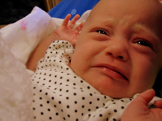 funny baby disgusted face