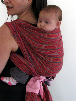Two shouldered back carry with ring sling for young baby