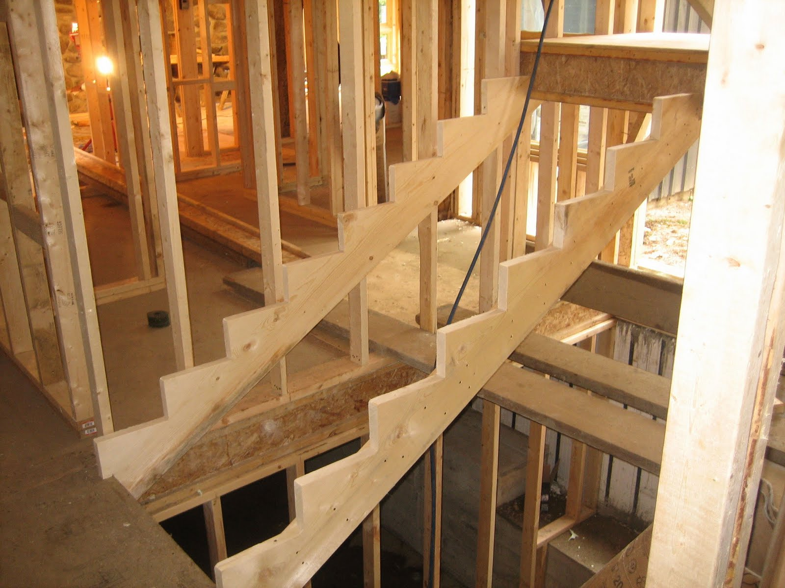 Hang Bottom Of Stair Stringers Below Floor With Joist