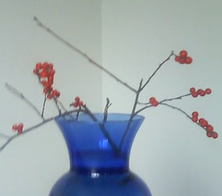 winterberry branches in vase