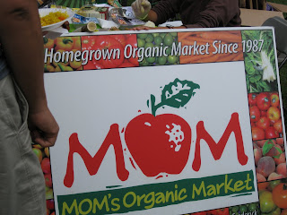 Moms Organic Market table sign