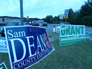 giant Sam Dean campaign sign