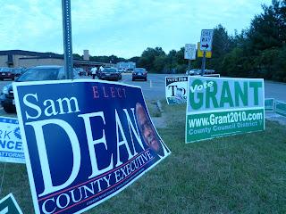 giant Sam Dean campaign sign
