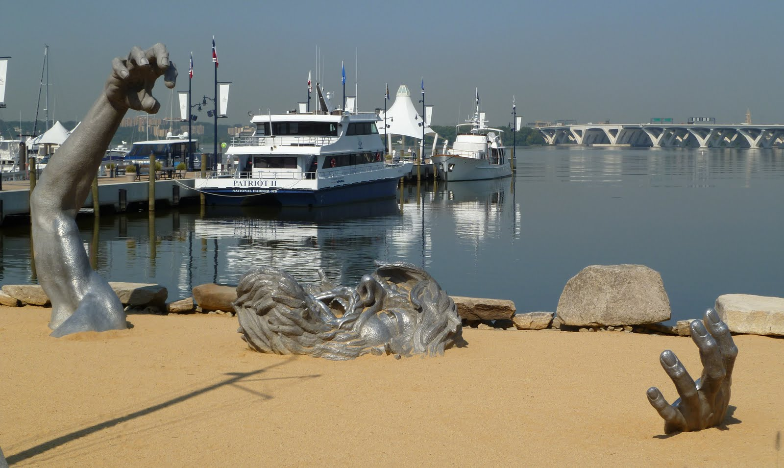 Comings and goings national harbor not disney on the for Awakening sculpture national harbor