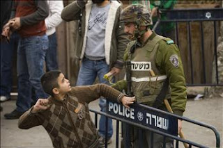 A brave young boy stands up to his occupier.