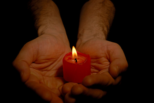 [candle+in+man's+hands+copy.jpg]