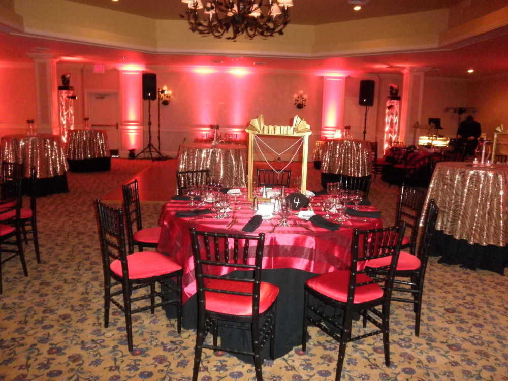 a warm and inviting cabaret style setting with lots of red and gold