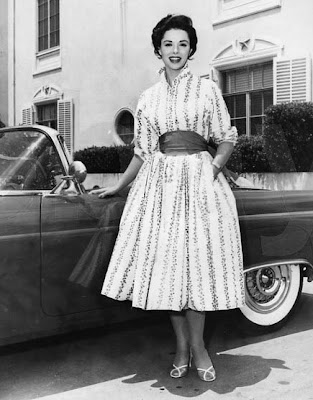 The lovely Dana Wynter with a nice car but an awful dress.