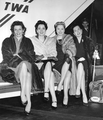 Jane Russell, Somebody-Somebody, Martha Hyer, and Ann Miller wait for their plane.