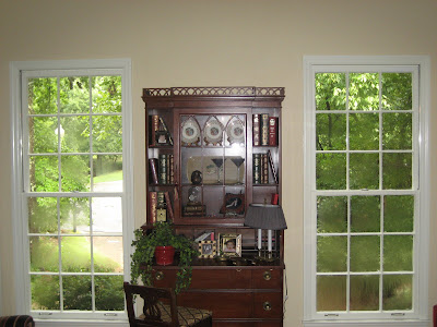 the cornice board was the perfect solution to hide the drapery yet still give the room the symmetrical appearance that colonial is noted for - Cornice Board
