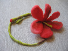 Red flower as a necklace
