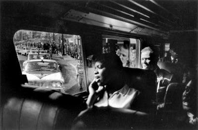During the 1961 Freedom Rides, Bruce Davidson captured this image of riders singing.
