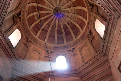 A shaft of light through a window in a dome in Fatehpur Sikri