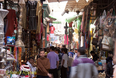 Khan el Khalili market in Cairo - shopping stuff hanging from both sides