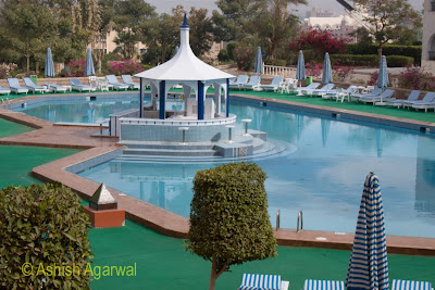 Basma Hotel in Aswan - a view of the beautiful swimming pool with chairs all around