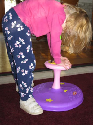 Bending Over the Sit N' Spin