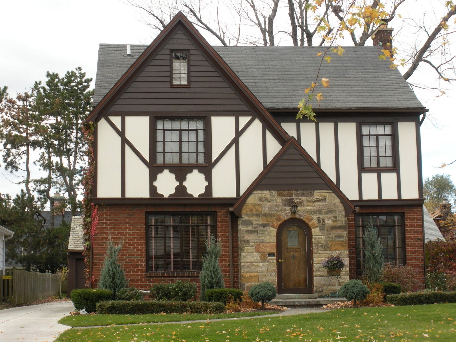 Reinventing the past housing styles of tudor ville and for Different types of doors for houses