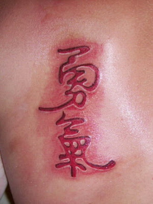 ink tattoo. Red ink tattoo