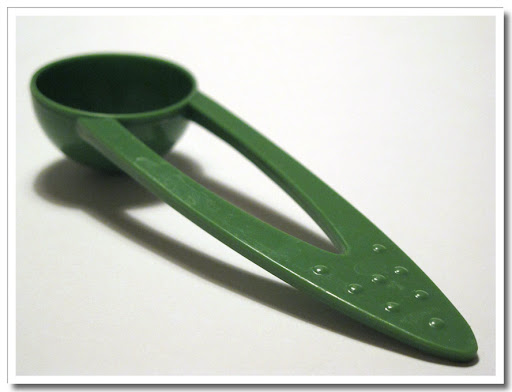 Kaffeskopa i grön plast