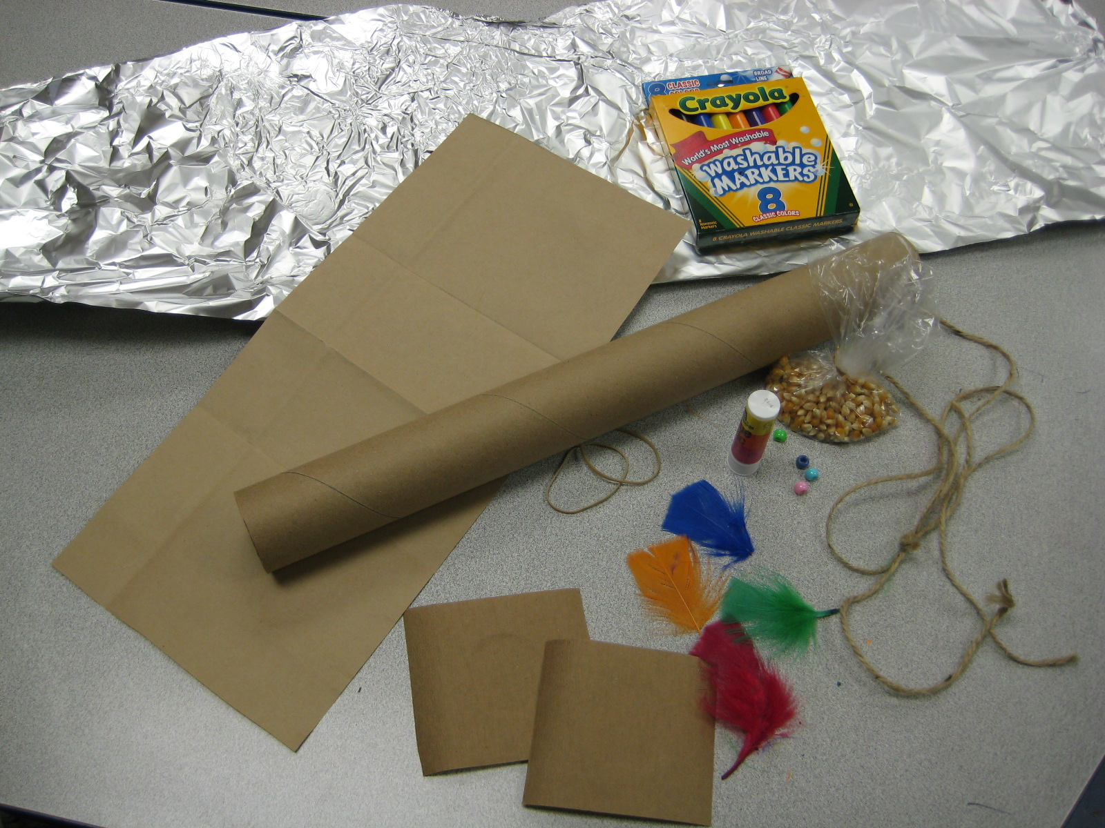 Preschool rain stick craft - 1 Glue Cardboard Circles Centered Onto The Squares Of Brown Paper And Set Aside 2 Lay Out The Long Strip Of Aluminum Foil And Carefully Scrunch It