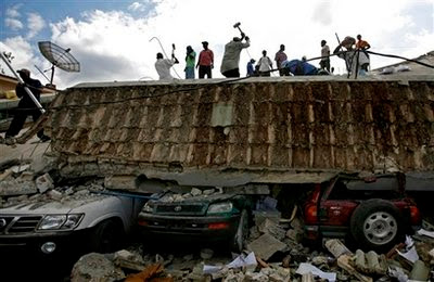 People search for survivors under the rubble of a collapse building.