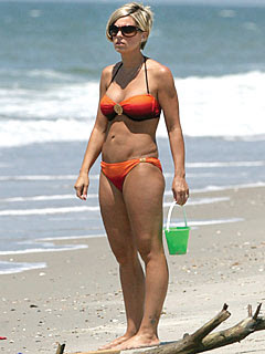 Kate Gosselin looking good in a bikini on the beach.