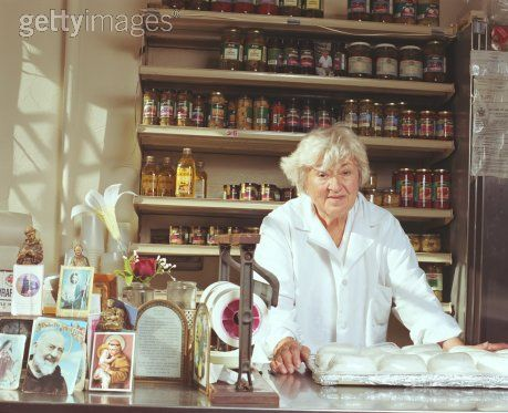 Elderly woman behind a counter in a small town lyrics