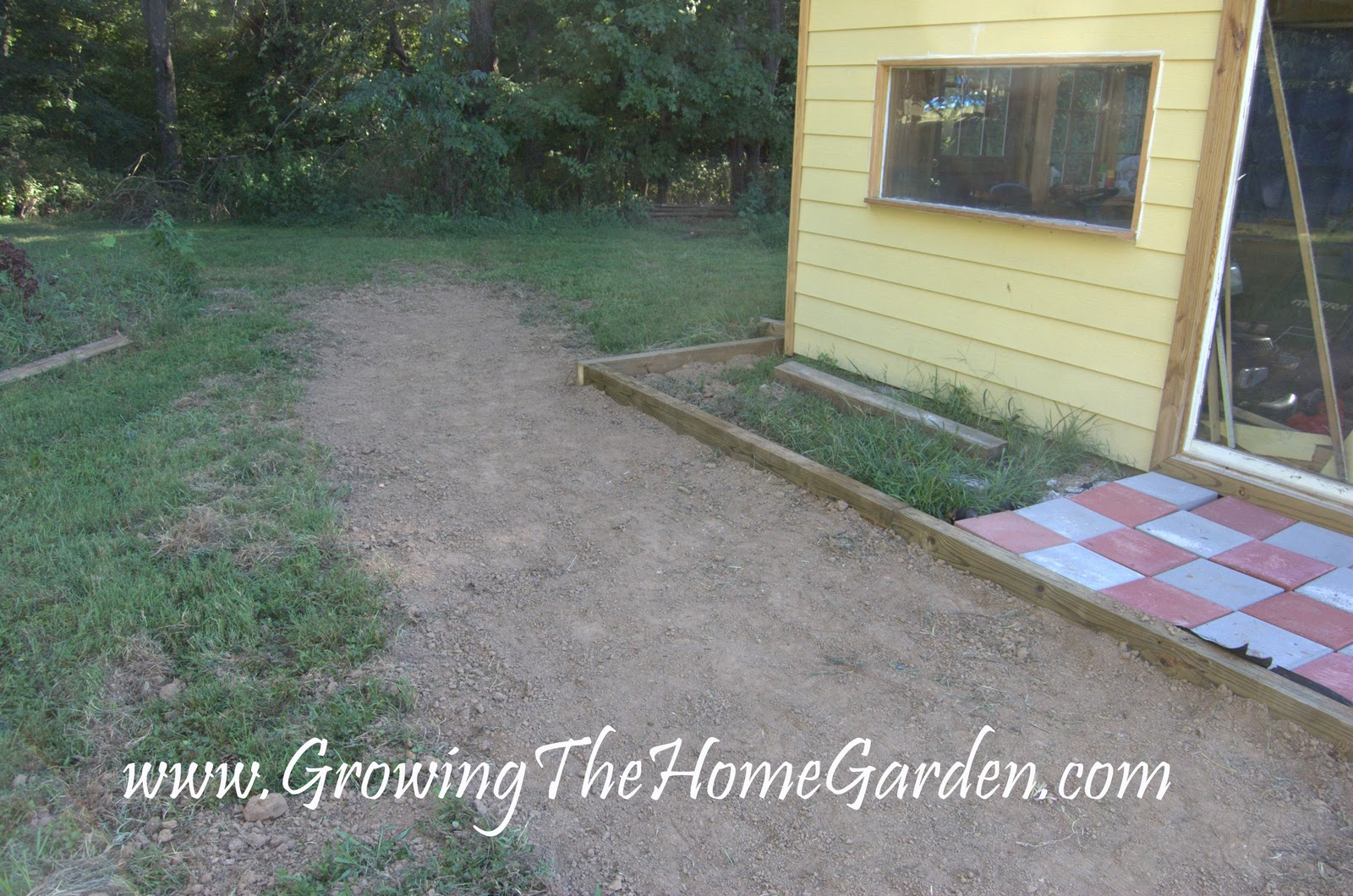 garden shed drainage pathway and loads of dirt growing the home