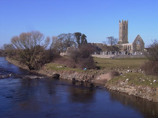 View of the River Clare and ruins of the Franciscan friary and graveyard, Claregalway, Co Galway, Ireland.