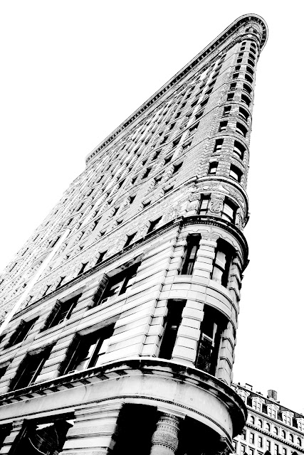 Looking up at the cool architecture of the Flatiron Building in New York City.