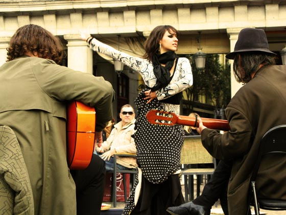 A sexy flamenco dancer and two guitarist performing in Plaza Mayor in Madrid.