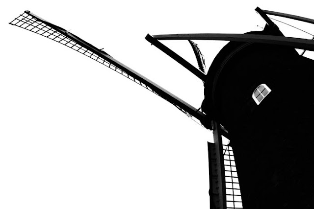 The Molen De Valk windmill and museum in Leiden, Holland.