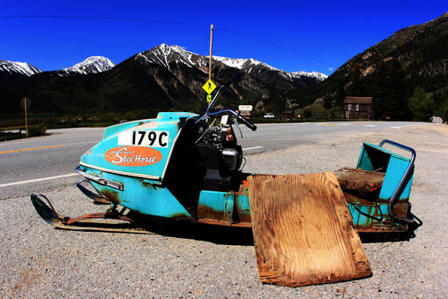 A really old Skee Horse Snowmobile parked right off the highway in Twin Lakes, Colorado.