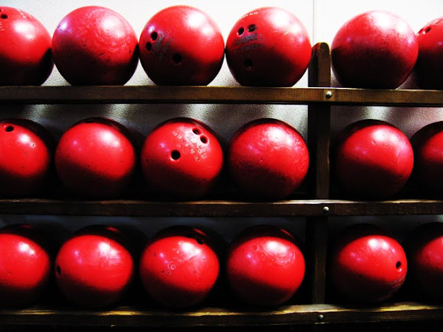 A rack of red bowling balls while doing some California bowling in Palo Alto.