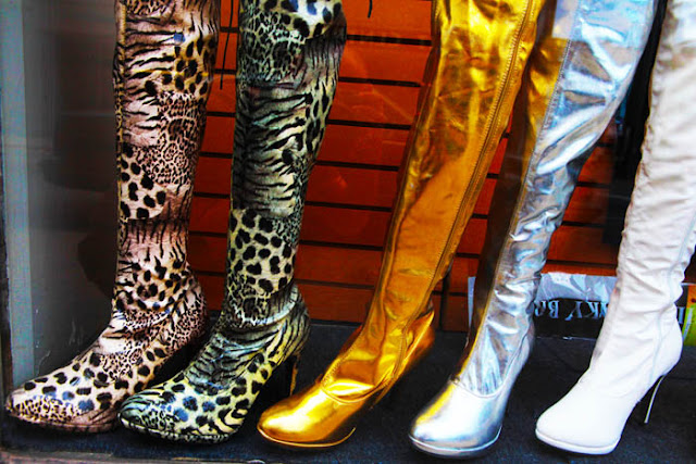 A window display filled with what look like prostitute boots in Louisville, Kentucky.