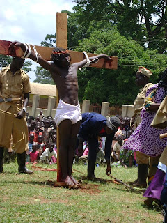 The Archbishop of the Church of Uganda, Luke Orombi, carrying a cross