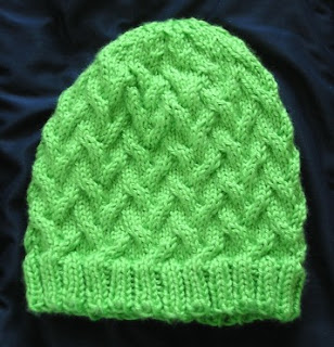 karma hat done in green acrylic