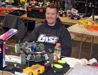 Team Losi Racing driver Lars Johnson (TQ) prepares his L8IGHT for the race
