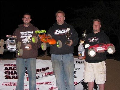 Losi drivers Billy Fischer and Casey Peck finish first and third in the truggy class.
