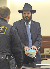 Rabbi Yaakov Weiss holds his prayer books Monday after being sentenced to 60 days in Jail.