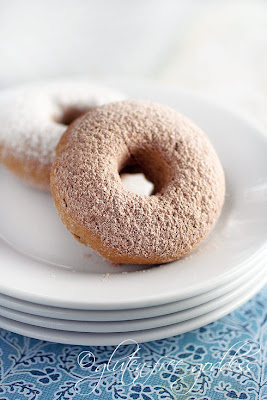 Old fashioned style gluten free powdered sugar donuts with cinnamon