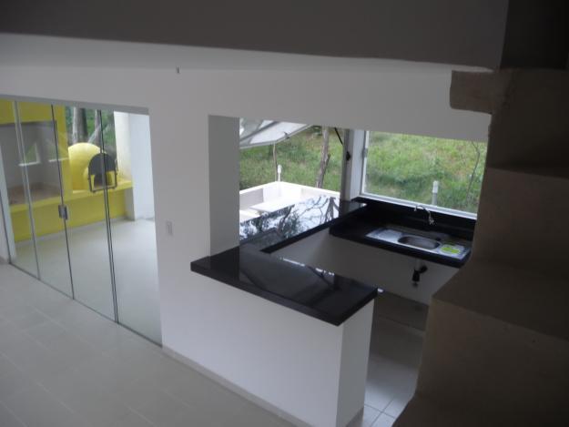 Construcciones y refacciones de casas departamentos for Casa minimalista rosario