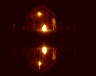 cabin and campfire reflected in pond KOA Canandaigua 2008 jcb