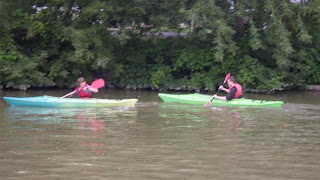 two boys in rented kayaks Erie Canal Fairport NY