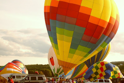 multi-colored hot air balloons warm up at Dansville Balloon Fest Sept 09